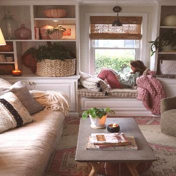 Easy fall decorating ideas in the living room, especially tips for styling your shelves with house