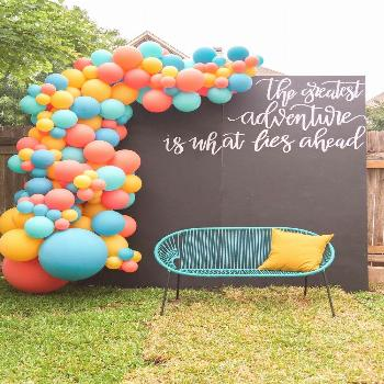 Graduation party photo booth ideas - create an oversized balloon garland with a DIY chalkboard back