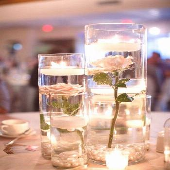 romantic diy floating roses and candles table centerpieces
