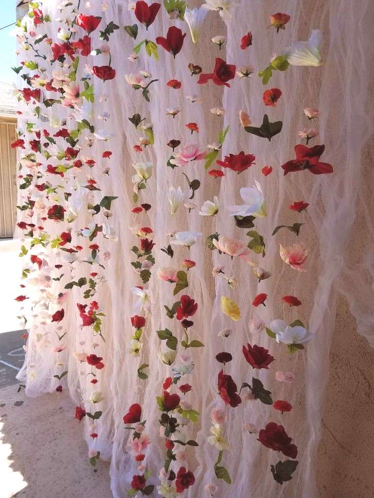 Engagement Party Flower Wall Decor. I bought a bunch of flowers at Dollar Tree, used fish string an